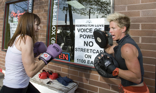Paul Fraughton  |  The Salt Lake Tribune Sarah Scott, left, works with Eliza James at James' boxing gym in Sugar House.                        Monday, April 29, 2013