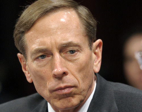 FILE - I this Feb. 2, 2012 file photo, CIA Director David Petraeus testifies on Capitol Hill in Washington. The former CIA director is making his first public speech since resigning in November over an extramarital affair. The former four-star general is speaking Tuesday night at a University of Southern California event honoring the military.  (AP Photo/Cliff Owen, File)