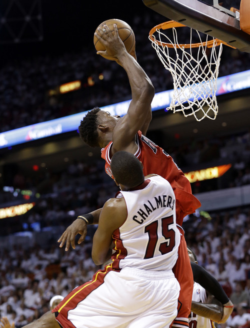 Chicago Bulls' Jimmy Butler shoots over Miami Heat's Mario Chalmers (15) during the second half of Game 5 of an NBA basketball Eastern Conference semifinal, Wednesday, May 15, 2013 in Miami. (AP Photo/Wilfredo Lee)