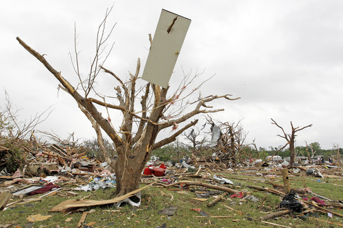 A door from a house is pierced by a tree limb in the destroyed Rancho Brazos neighborhood os Granbury, Texas, Thursday, May 16, 2013. A rash of tornadoes slammed into several small communities in North Texas overnight, leaving at least six people dead, dozens more injured and hundreds homeless.  (AP Photo/The Fort Worth Star-Telegram, Paul Moseley)  MAGS OUT; (FORT WORTH WEEKLY, 360 WEST)