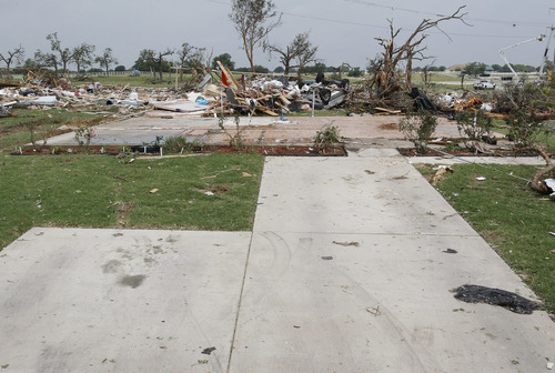 An empty driveway leads to what was once a home, with only the slab left of a house swept off of its foundation by a tornado, in Granbury, Texas, Thursday, May 16, 2013. A rash of tornadoes slammed into several small communities in North Texas overnight, leaving at least six people dead, dozens more injured and hundreds homeless.  (AP Photo/The Fort Worth Star-Telegram, Paul Moseley)  MAGS OUT; (FORT WORTH WEEKLY, 360 WEST)