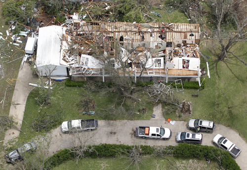 A heavily damaged home in Cleburne, Texas is seen in an aerial view on Thursday May 16, 2013.  Multiple tornados hit the area last night. Ten tornadoes touched down in several small communities in North Texas overnight, leaving at least six people dead, dozens injured and hundreds homeless.    (AP Photo/The Fort Worth Star-Telegram, Ron T. Ennis)  MAGS OUT