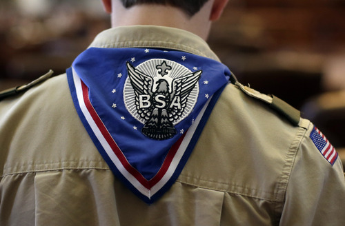 A Boy Scout wears an Eagle Scot neckerchief during the annual Boy Scouts Parade and Report to State in the House Chambers at the Texas State Capitol, Saturday, Feb. 2, 2013, in Austin, Texas. Perry says he hopes the Boy Scouts of America doesn't move soften its mandatory no-gays membership policy. (AP Photo/Eric Gay)