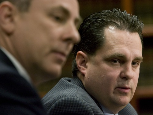 Davis County Deputy Attorney Ron Dunn (left) and Davis County attorney Troy Rawlings (right) talk to the media in March 31, 2008. Steve Griffin/The Salt Lake Tribune.