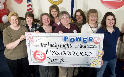 FILE - In this March 18, 2008 file photo, eight co-workers in the Monongalia County Tax Office claim their $276 million Powerball prize in Charleston, W.Va. Work pools for big jackpots are often fraught with controversy, resulting in lawsuits, broken friendships and worse: delayed payouts. (AP Photo/Bob Bird, File)