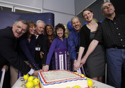 FILE - In this March 31, 2011 file photo, co-workers, from left: Leon Peck; Kristin Baldwin; Mike Barth; New York Lottery's Yolanda Vega; Tracy Sussman; John Kutey; Gabrielle Mahar, and John Hilton cut a cake that is a replica of their $319 Mega Millions winning lottery ticket during a news conference in Schenectady, N.Y. Work pools for big jackpots are often fraught with controversy, resulting in lawsuits, broken friendships and worse: delayed payouts. (AP Photo/Mike Groll, File)
