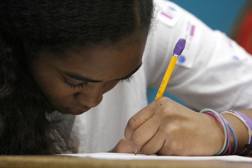 Francisco Kjolseth  |  The Salt Lake Tribune Nneka Saunders, 12, a fifth-grade student at Wasatch Peak Academy concentrates on her advanced math class work in Mark Carlson's class. For the first time, Utah State Charter School Board has gathered performance information on the state's 81 charter schools in three areas: academic, financial and governance. Academic performance measures include student proficiency on end-of-year tests, student growth on end-of-year tests, student retention, graduation rates, and ACT scores.