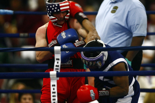 Chris Detrick  |  The Salt Lake Tribune West Jordan's Larry Gomez, in red, fights Kareem Martin, of Washington D.C., in the 152 lb boxing match during the National Golden Gloves Boxing tournament at the Calvin L. Rampton Salt Palace Convention Center Thursday May 16, 2013. Martin won the match.