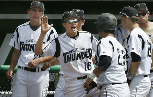 Scott Sommerdorf   |  The Salt Lake Tribune Thunder first baseman Blake Betts gets congratulations after his RBI as Desert Hills beat Carbon 2-0 to advance in the 3A playoffs, Thursday, May 16, 2013.