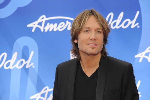 "Keith Urban arrives at the ""American Idol"" finale at the Nokia Theatre at L.A. Live on Thursday, May 16, 2013, in Los Angeles. (Photo by Chris Pizzello/Invision/AP)"