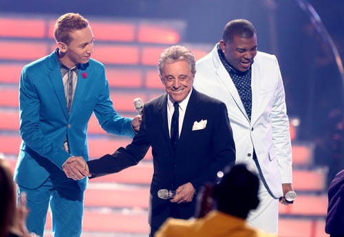 "Frankie Valli, center, and former contestants Devin Velez, left, and Curtis Finch Jr perform at the ""American Idol"" finale at the Nokia Theatre at L.A. Live on Thursday, May 16, 2013, in Los Angeles. (Photo by Matt Sayles/Invision/AP)"