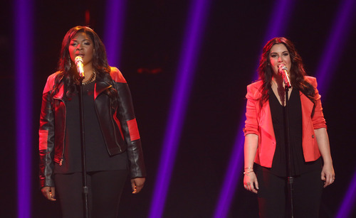 "Finalists Candice Glover, left, and Kree Harrison perform at the ""American Idol"" finale at the Nokia Theatre at L.A. Live on Thursday, May 16, 2013, in Los Angeles. (Photo by Matt Sayles/Invision/AP)"