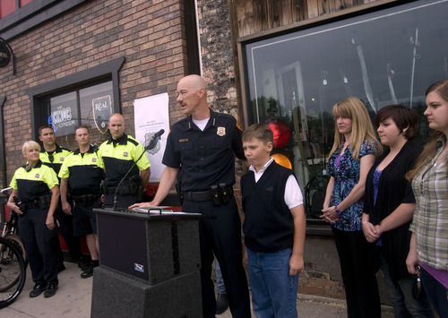 Kim Raff  |  The Salt Lake Tribune Salt Lake City Police Chief Chris Burbank speaks during Salt Lake Police Department dedication of a plaque in memory of Officer Michael Dunman, who was killed while on duty 13 years ago, outside Piper Down Pub in Salt Lake City on May 17, 2013.