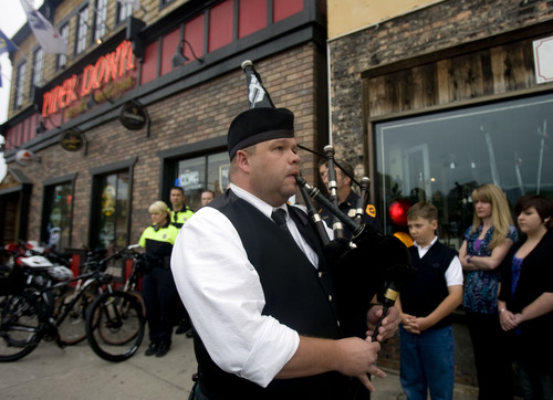 Kim Raff  |  The Salt Lake Tribune Dave Glad plays the bagpipes during Salt Lake Police Department's dedication of a plaque in memory of Officer Michael Dunman, who was killed while on duty 13 years ago, outside Piper Down Pub in Salt Lake City on May 17, 2013.