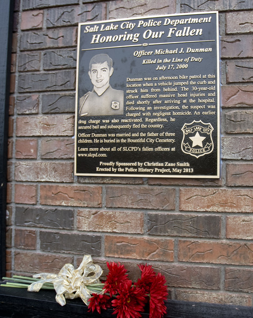 Kim Raff  |  The Salt Lake Tribune The Salt Lake Police Department dedicates a plaque in memory of Officer Michael Dunman, who was killed while on duty 13 years ago, outside Piper Down Pub in Salt Lake City on May 17, 2013.