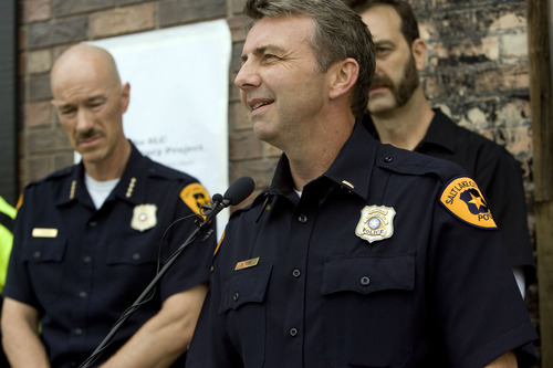 Kim Raff  |  The Salt Lake Tribune Salt Lake Police Department Lt. Mike Ross speaks during Salt Lake Police Department's dedication of a plaque in memory of Officer Michael Dunman, who was killed while on duty 13 years ago, outside Piper Down Pub in Salt Lake City on May 17, 2013.