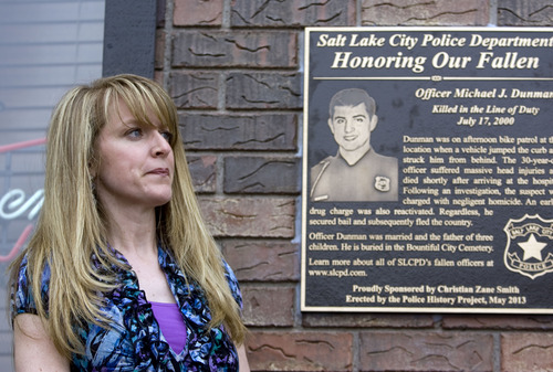 Kim Raff  |  The Salt Lake Tribune Sandi Bromley attends the Salt Lake Police Department's dedication of a plaque in memory of her late husband, Officer Michael Dunman, who was killed while on duty 13 years ago, outside Piper Down Pub in Salt Lake City on May 17, 2013.