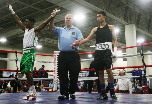 Kim Raff  |  The Salt Lake Tribune Texas boxer (right) Hector Tanajara reacts as (left) Stephen Fulton Jr., from Pennsylvania, is declared the winner of the 114 lb. weight class semifinal match of the 2013 Golden Gloves National Tournament in Salt Lake City on May 17, 2013.