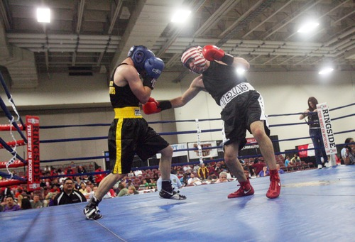 Kim Raff  |  The Salt Lake Tribune Texas boxer (right) George Rincon punches (left) Julian Rodriguez, of New Jersey, during the 141 lb. weight class semifinal match of the 2013 Golden Gloves National Tournament in Salt Lake City on May 17, 2013. Rodriguez upset Rincon and won the match by decision.