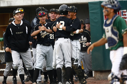 Chris Detrick  |  The Salt Lake Tribune Desert Hills' Baden Powell (19) celebrates with his teammates after scoring a run during the game at Brent Brown Ballpark at Utah Valley University Friday May 17, 2013. Desert Hills defeated Snow Canyon 5-4.