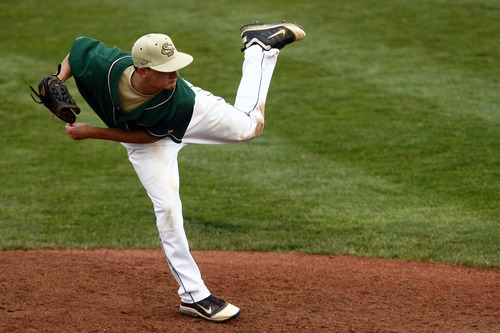 Chris Detrick  |  The Salt Lake Tribune Snow Canyon's Clint Gates (2) pitches during the game at Brent Brown Ballpark at Utah Valley University Friday May 17, 2013. Desert Hills defeated Snow Canyon 5-4.