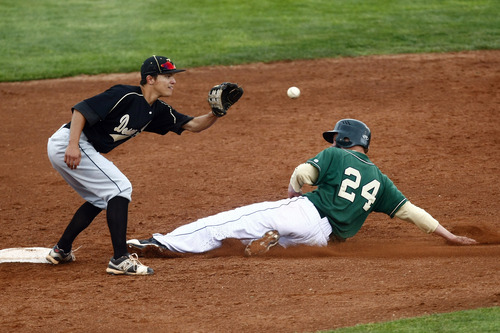 Chris Detrick  |  The Salt Lake Tribune Snow Canyon's Brogan Secrist (24) slides safely into second base past Desert Hills' Evan Moss (28) during the game at Brent Brown Ballpark at Utah Valley University Friday May 17, 2013. Desert Hills defeated Snow Canyon 5-4.
