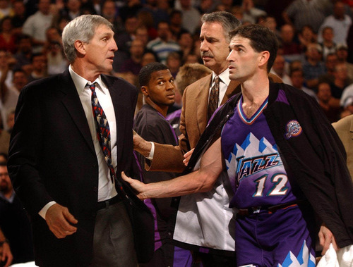 Utah Jazz head coach Jerry Sloan, left, is escorted off the court by assistant coach Phil Johnson and John Stockton, right, as DeShawn Johnson, middle, watches the commotion Tuesday, Jan. 28, 2003, in Sacramento, Calif. Sloan was ejected for shoving official Courtney Kirkland in the first quarter after arguing that Kings guard Doug Christie stepped out of bounds on the sideline right near where Kirkland was standing. Sloan got down and put his hand to the spot where he thought Christie stepped out. Sloan then shoved Kirkland and was immediately ejected. (AP Photo/The Sacramento Bee, Hector Amezcua)