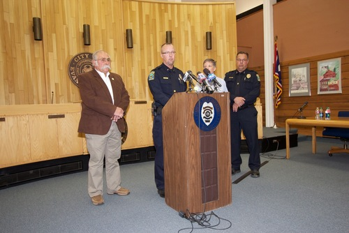 Evanston Police speak to the media after a man was fatally shot when he allegedly pointed a rifle at police Saturday, May 19. Police said the man had earlier fired a shot in a residential area and another shot at a Sports World store. Courtesy Mike Jensen  |  Uinta County Herald