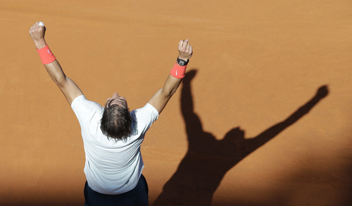 Spain's Rafael Nadal, celebrates after winning the final match against Roger Federer of Switzerland at the Italian Open tennis tournament in Rome, Sunday, May 19, 2013.   (AP Photo/Alessandra Tarantino)