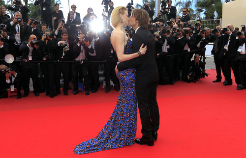 Actress Nicole Kidman kisses her husband singer Keith Urban as they arrive for the screening of the film Inside Llewyn Davis at the 66th international film festival, in Cannes, southern France, Sunday, May 19, 2013. (Photo by Joel Ryan/Invision/AP)