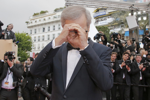 Director and jury president Steven Spielberg gestures as he arrives for the screening of the film Inside Llewyn Davis at the 66th international film festival, in Cannes, southern France, Sunday, May 19, 2013. (AP Photo/Francois Mori)