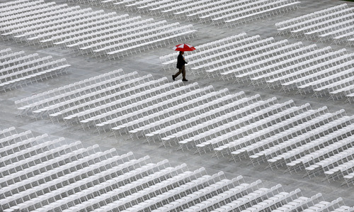 A man walks through Rutgers University's football stadium before graduation ceremonies in Piscataway, N.J., Sunday, May 19, 2013. (AP Photo/Mel Evans)