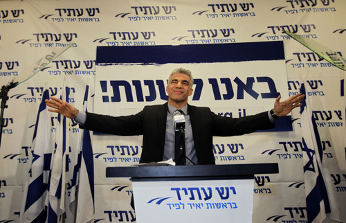 """Yair Lapid gestures as he delivers a speech at  his """"Yesh Atid"""" party in Tel-Aviv Wednesday, Jan. 23, 2013.  The party, formed just over a year ago, out did forecasts by far and are predicted to capture as many as 19 seats, becoming parliament's second-largest party, after Netanyahu's Likud-Beiteinu bloc, which won 31, according to the exit polls. (AP Photo/Sebastian Scheiner)"""