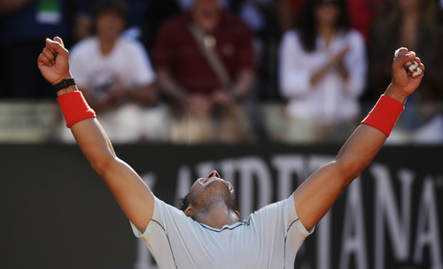 Spain's Rafael Nadal celebrates after defeating Switzerland's Roger Federer at the final match of the Italian Open tennis tournament in Rome, Sunday, May 19, 2013. Nadal won 6-1, 6-3. (AP Photo/Andrew Medichini)