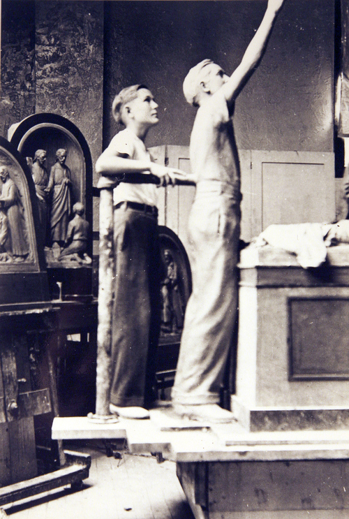 (Salt Lake Tribune Archives)  A young boy stands next to a statue to be placed on the Salt Lake City and County Building on 400 S. State St. The building was originally constructed by Freemasons between 1891 and 1894. Construction of the building was riddled with controversy. During the late 19th and early 20th centuries the City and County Building was the symbol of non-Mormon citizens' open defiance of The Church of Jesus Christ of Latter-day Saints. It was designed to rival the Salt Lake Temple as the city's architectural centerpiece. It is even thought that the building's clock tower and statues were designed to mimic the temple's spires and statue of the angel Moroni.