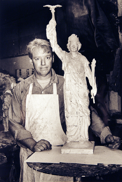"""(Salt Lake Tribune Archives)  Artist Richard Young with a scale model of the statue """"Columbia"""" placed on top of the Salt Lake City and County Building on 400 S. State St."""