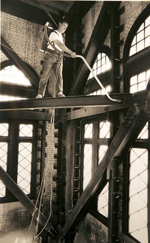 (Salt Lake Tribune Archives)  Steve Thunell vacuums beams inside the tower of the Salt Lake City and County Building on 400 S. State St.