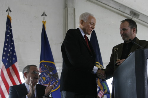 Trent Nelson | The Salt Lake Tribune Sen. Orrin Hatch, left, receives a minature golden shovel from Harvey Davis, director for installations and logistics at the National Security Agency, during the groundbreaking ceremony for the Utah Data Center on Jan. 6, 2011.