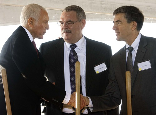 Trent Nelson  |  The Salt Lake Tribune Senator Orrin Hatch (left) shakes hands with John Inglis, Deputy Director of the National Security Agency, at the groundbreaking ceremony for the NSA's Utah Data Center at Camp Williams, Thursday, January 6, 2011. The cybersecurity facility is expected be completed and open October 2013. At center is Thomas Bell.