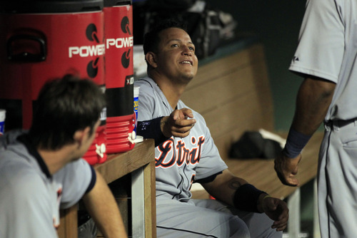 Detroit Tigers third baseman Miguel Cabrera (24) talks with teammates in the dugout, after hitting a second home run a baseball game against the Texas Rangers Sunday, May 19, 2013, in Arlington. He hit three home runs in the game. (AP Photo/John F. Rhodes)