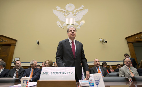"""FILE – In this Sept. 20, 2012, file photo Michael Horowitz, the Justice Department's inspector general, arrives to testify before the House Oversight and Government Reform Committee after faulting the department for disregard of public safety in """"Operation Fast and Furious."""" (AP Photo/J. Scott Applewhite, File)"""