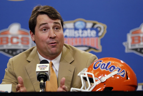 Florida head coach Will Muschamp talks with reporters in New Orleans Tuesday, Jan. 1, 2013.  (AP Photo/Bill Haber)