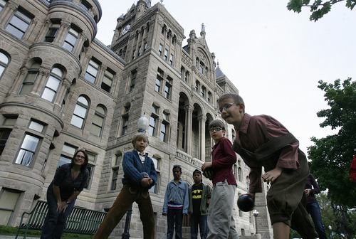 Scott Sommerdorf  |  The Salt Lake Tribune A game of Bocce ball at one of two courts set up at the Living Traditions festival near the City and County building in downtown Salt Lake City on Friday.