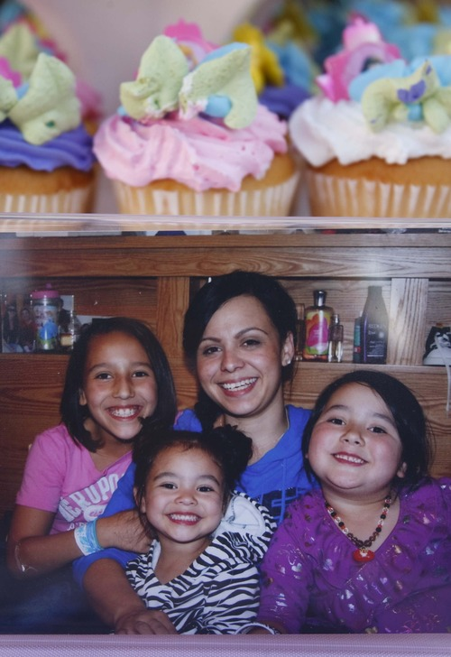 Leah Hogsten  |  The Salt Lake Tribune A photo of Danielle Lucero and her three daughters adorn the front of the pyramid of cupcakes at Aliveah Montoya's birthday party. Magical Celebration hosted a princess birthday party for Aliveah Montoya, 4, and her two sisters Ava Montoya, 6, and Analise Lucero, 9, on Saturday, May 18, 2013, after hearing about the shooting death of the girls' mother, Danielle Lucero. Magical Celebration hosted a princess birthday party for Aliveah and her two sisters Ava Montoya, 6, and Analise Lucero, 9, after hearing about the shooting death of the girls' mother, Danielle Lucero. Lucero was one of three people shot and killed inside a Midvale home in February.