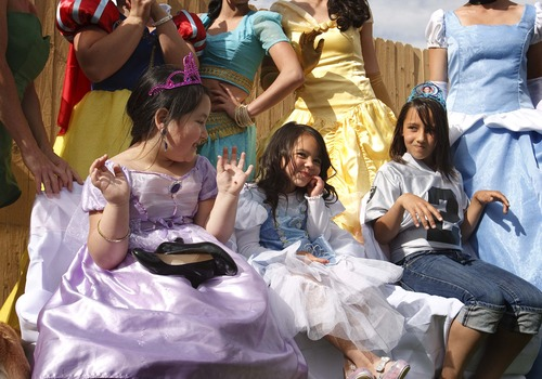 Leah Hogsten  |  The Salt Lake Tribune l-r Sisters Ava Montoya, 6, Aliveah Montoya, 4, and Analise Lucero, 9, celebrated Aliveah's princess birthday party with family and friends.  Magical Celebration hosted a princess birthday party for Aliveah Montoya, 4, and her two sisters Ava Montoya, 6, and Analise Lucero, 9, after hearing about the shooting death of the girls' mother, Danielle Lucero, Saturday, May 18, 2013. Lucero was one of three people shot and killed inside a Midvale home in February in what police called a coordinated and systematic attack by ex-con David Fresques.