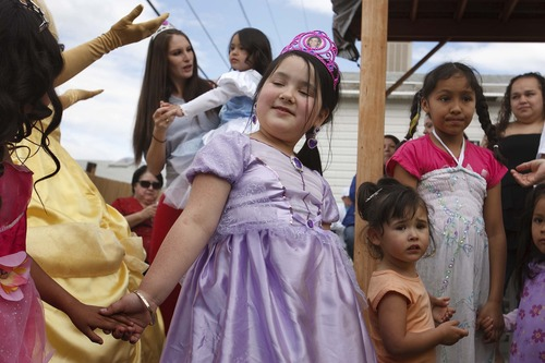 Leah Hogsten  |  The Salt Lake Tribune Ava Montoya, 6, celebrates with her sister Aliveah (background) and family and friends during Aliveah's birthday party on Saturday. Magical Celebration hosted a princess birthday party for Aliveah and her two sisters Ava Montoya, 6, and Analise Lucero, 9, after hearing about the shooting death of the girls' mother, Danielle Lucero. Lucero was one of three people shot and killed inside a Midvale home in February.