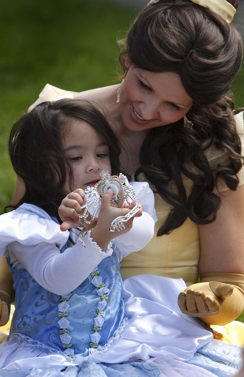 Leah Hogsten  |  The Salt Lake Tribune Aliveah Montoya, 4, shows off her tiara to Princess Belle during the party. Magical Celebration hosted a princess birthday party for Aliveah Montoya, 4, and her two sisters Ava Montoya, 6, and Analise Lucero, 9, on Saturday, May 18, 2013, after hearing about the shooting death of the girls' mother, Danielle Lucero. Magical Celebration hosted a princess birthday party for Aliveah and her two sisters Ava Montoya, 6, and Analise Lucero, 9, after hearing about the shooting death of the girls' mother, Danielle Lucero. Lucero was one of three people shot and killed inside a Midvale home in February.