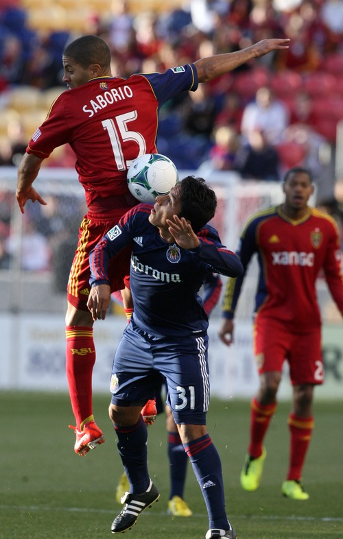 Kim Raff  |  The Salt Lake Tribune (left) Real Salt Lake forward Alvaro Saborio (15) and Chivas USA midfielder Marvin Iraheta (31) compete for ball in the air during the first half of a game at Rio Tinto Stadium in Sandy on April 20, 2013.