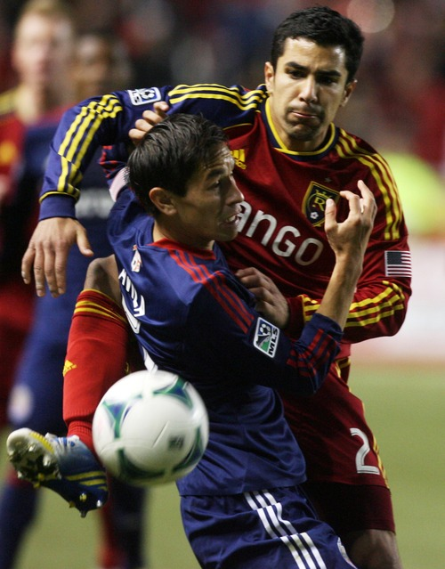 Kim Raff  |  The Salt Lake Tribune (back) Real Salt Lake defender Tony Beltran (2) competes with (front) Chivas USA midfielder Eric Avila (15) for a ball during the second half at Rio Tinto Stadium in Sandy on April 20, 2013. Real went on to win the game 1-0.