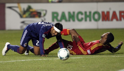 Kim Raff  |  The Salt Lake Tribune (right) Real Salt Lake forward Robbie Findley (10) and Chivas USA defender Joaquin Velazquez (23) collide during the second half of a game at Rio Tinto Stadium in Sandy on April 20, 2013. Real went on to win the game 1-0.